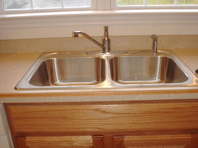 A Kitchen Sink : ... , enter the latest -- a mainstay of the American kitchen -- its sink